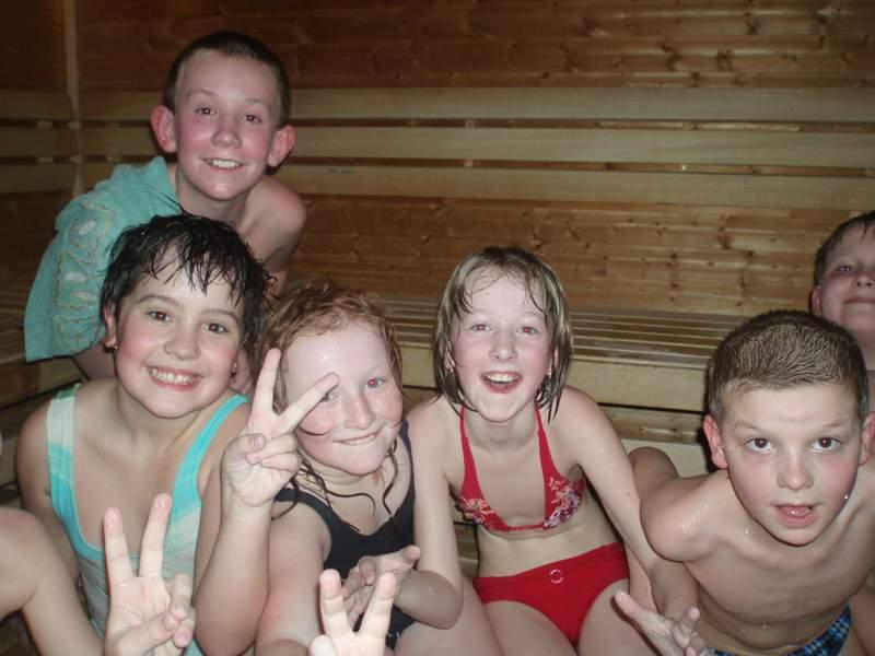 changing-boy-sauna-nudist-topless-busty-babes