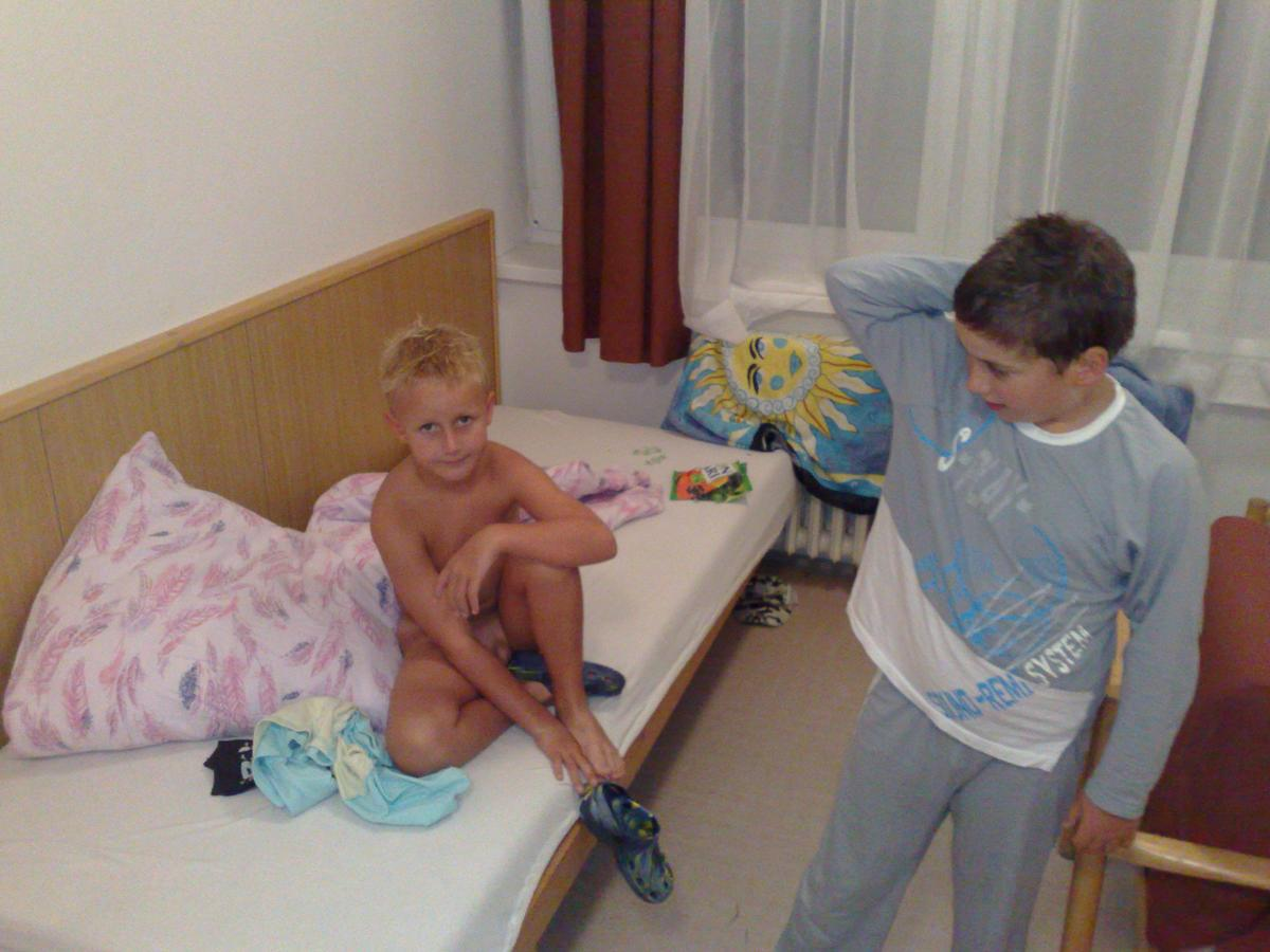 nudist family in bed
